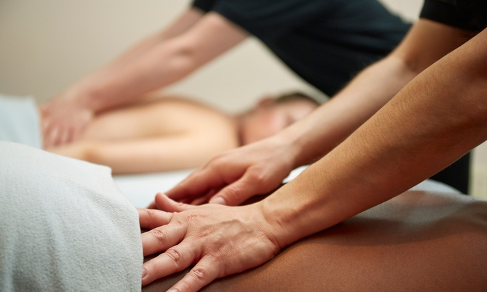 Ahhh! Massage - D'Andrea Shopping Center: $99.99 for a Couples Spa Package with Massage and Detoxifying Sauna Session at Ahhh! Massage ($230 Value)