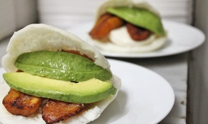 Venezuelan Arepas and Mango or Passionfruit Sangria for Two or Four at Arepas Grill (46% Off)