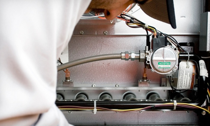 KC A/C Heating, Plumbing and Rooter - customers home.: $49 for a Furnace Tune-Up and Safety Check from KC A/C Heating, Plumbing and Rooter ($169 Value)