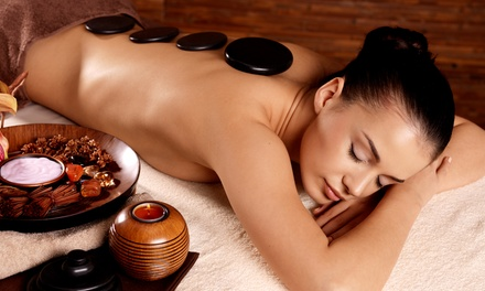 70-Minute Hot Stone Massage at Forever Sunshine - Herbal Health (52% off)
