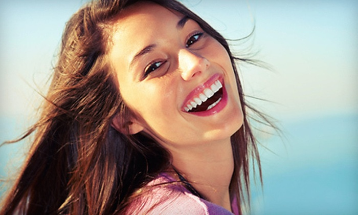 Golden Tans - Multiple Locations: One or Two Beaming White Teeth-Whitening Treatments at Golden Tans (Up to 68% Off)