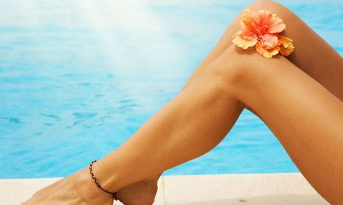 Tiki Tan Express - Multiple Locations: Up to 83% Off Airbrush Tans and Tanning Beds at Tiki Tan Express