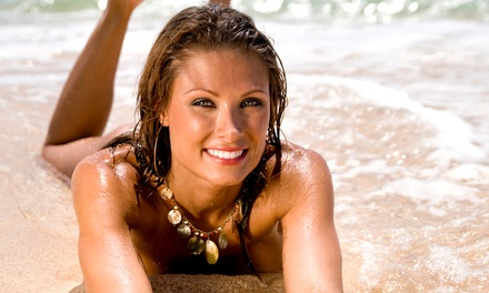 $30.99 for One Month of Unlimited UV Tanning or Three VersaSpa Spray Tans at Boca Tanning Club (66% Value)