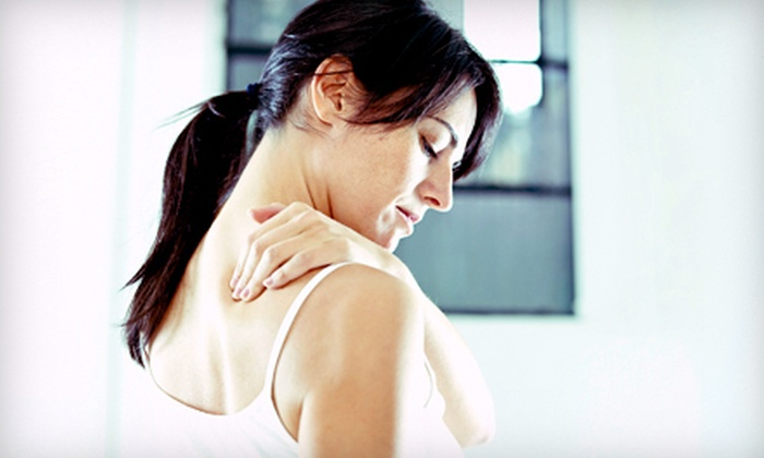 Moore Chiropractic Group - Aurora: $39 for a Consultation and Three Spinal-Decompression Treatments at Moore Chiropractic Group in Aurora ($750 Value)