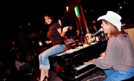 Dallas: Dueling-Piano Show and Pizza for 2, 4, 8, or 12 on Friday or Saturday at Louie Louie's Piano Bar (Up to 67% Off)