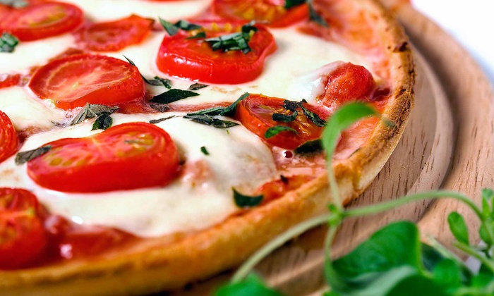 Ottimo Pizza & Trattoria - White Plains: Large Pizza with Wine or Salad for Two People at Ottimo Pizzeria and Trattoria (Up to 50% Off)
