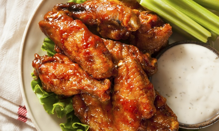 The Rush - Sioux Falls: $12 for $20 Worth of American Grill Fare at The Rush
