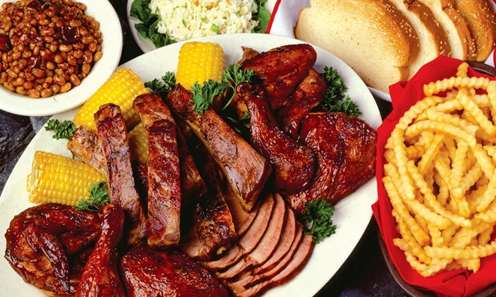 Woody's BBQ - Sterling Heights: Dinner for Two or Four with Appetizers and Entrees or $11 for $20 Worth of Barbecue at Woody's BBQ