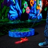 Up to 50% Off Indoor Black-Light Mini Golf
