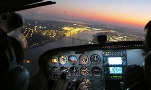 Flight Academy of New Orleans  LLC: Big Easy Aerial Tour for Two, or One- or Three-Lesson Flight Package from Flight Academy of New Orleans (50% Off)