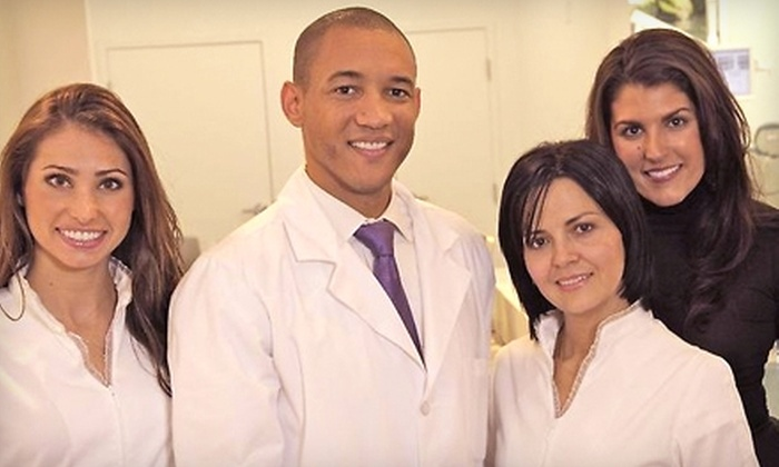 Smile Design Manhattan - Midtown Center: $99 for Dental Exam and Cleaning ($520 Value), Plus Your Choice of Zoom! Whitening Treatment ($650 Value), $2,000 Off Invisalign, or $1,500 Off Implant Placement at Smile Design Manhattan