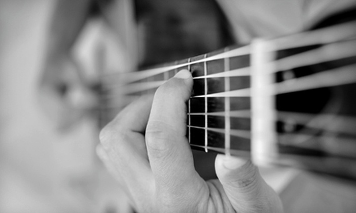 Blue Raven Music Studios - Lincoln: $30 for One Month of Music Lessons and Guitar Rental at Blue Raven Music Studios (Up to $85 Value)