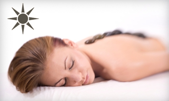 Solaire Hair Studio and Spa - Historic Hudson: $39 for One-Hour Full-Body Massage or Deep-Cleansing Facial at Solaire Hair Studio and Spa ($90 Value)