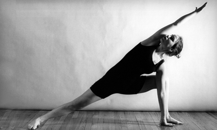 Divine Yoga - Uptown Broadway: $25 for One Month of Unlimited Classes at Divine Yoga (Up to $70 Value)