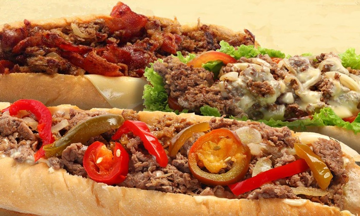 The Cheese Steak Shop - Downtown: $12 for Four Groupons, Each Good for $6 Worth of Sandwiches at The Cheese Steak Shop ($24 Total Value)