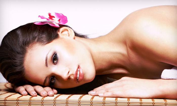 Darque Tan - Multiple Locations: Three or Five Spray-Tan Packages with Red-Light Therapy or Three or Five Spray Tans at Darque Tan (Up to 77% Off)