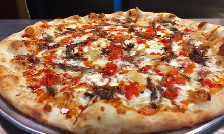 $16 for Two Groupons, Each Good for $15 Worth of Italian Food for Two or More at Revolution Pizza ($30 Total Value)