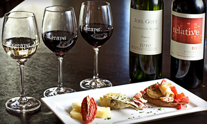 The Grape Wine Bar and Bistro - Atlantic Station: Wine Flight for Two or Four or Wine Flight with Food Pairing for Four at The Grape Wine Bar and Bistro (Up to 61% Off)