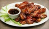 The Sports Grill - Rensselaer: American Comfort Food for Lunch or Dinner for Two or for Dinner for Four at The Sports Grill (Up to 51% Off)