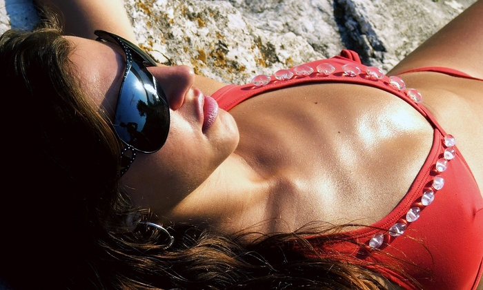 Hollywood Tans - West Windsor: UV or Spray Tanning at Hollywood Tans (Up to 75% Off). Three Options Available.
