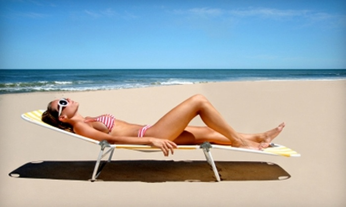 Cool Rays Tanning Salon - Huron Heights: Tanning Packages and Products or Two Spray Tans at Cool Rays Tanning Salon
