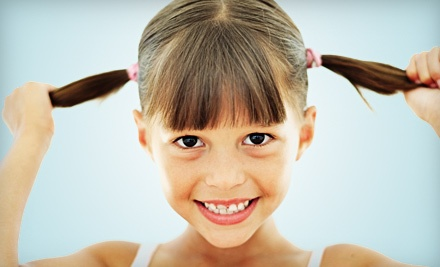 Child's Shampoo and Haircut (up to a $15 value) - Family Hair Express in Rochester