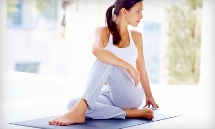 East Lansing Hot Yoga - East Lansing: 12 Drop-In Classes or One Year of Unlimited Classes at East Lansing Hot Yoga (Up to 85% Off)