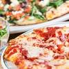 Pizza gourmet e calice di vino