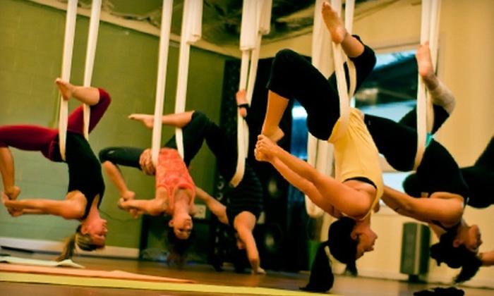 Studio Revolution - Morena: $30 for Five Revolution Yoga, Acro Yoga, or Aerial Yoga Classes at Studio Revolution ($75 Value)