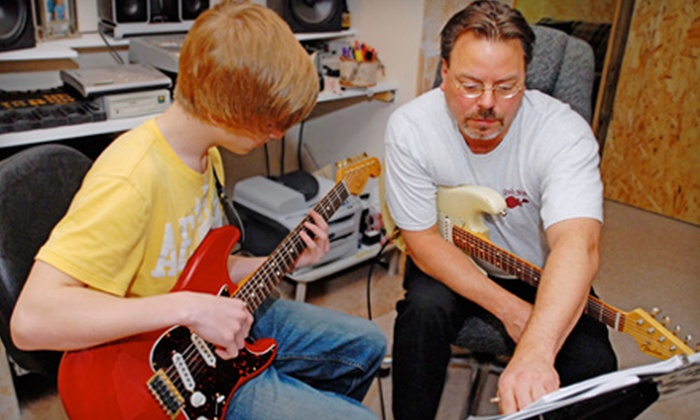 Oslo Studios - Burnsville: $42 for Guitar-Instruction Package with Four Lessons and Introductory Booklet at Oslo Studios in Burnsville ($84 Value)