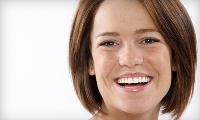 Smiling Bright - Downtown: $29 for a Teeth-Whitening Kit with LED Light from Smiling Bright ($180 Value)