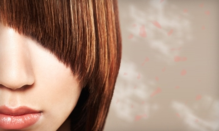 Tina Cimino Studio - Rochester: $20 for a Women's Haircut ($40 Value) or $40 for Women's Cut and Color Service ($80 Value) at Tina Cimino Studio