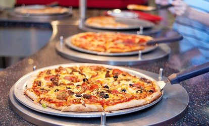 image for Buffet, Video Games, and Attractions for Two or Four at Warr Acres Incredible Pizza Company (Up to 47% Off)