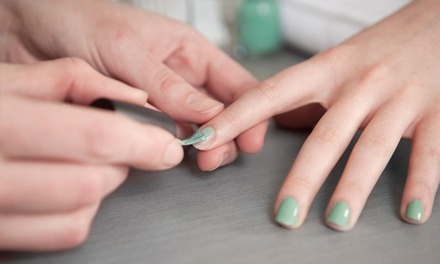 Mani-Pedis at At Your Fingertips Nail Salon (Up to 55% Off). Three Options Available.