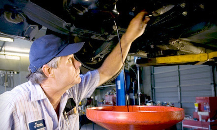 K & M Auto Service - Multiple Locations: Regular or Synthetic Oil-Change Package with Inspection and Wiper Blades from K and M Auto Service (Up to 71% Off)