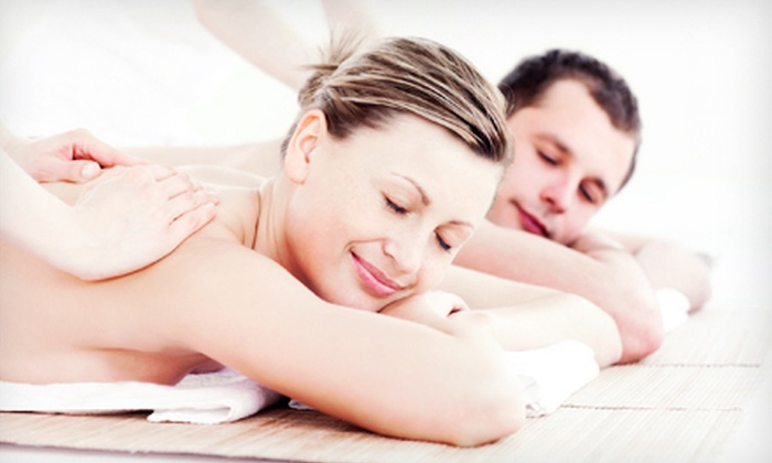 New Paradigm Massage - Cherry Creek: $95 for a Couples Massage with Aromatherapy Foot Soak and Wine or Champagne at New Paradigm Massage (Up to $190 Value)