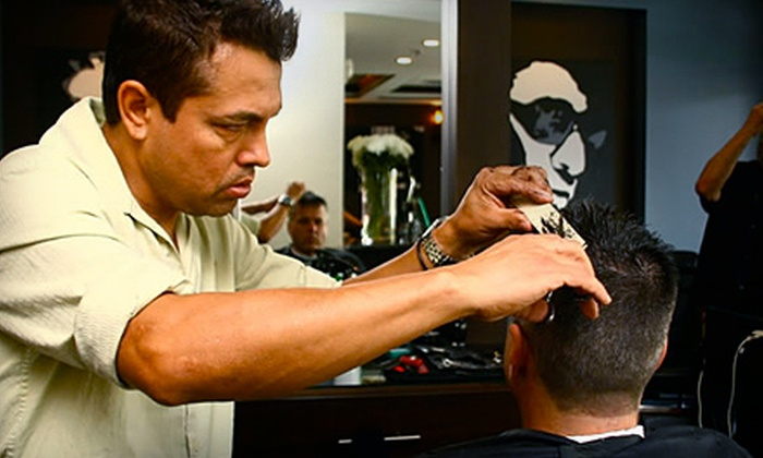 ManCave for Men - Glades South Plaza: $45 for 15-Minute Scalp Massage, 15-Minute Chair Massage, Haircut, Wash and Hot Shave at ManCave for Men in Boca Raton ($95 Value)