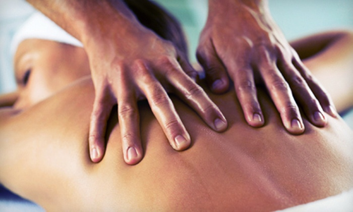Powell Chiropractic Center - Gainesville: Massage, Exam, and Adjustment at Powell Chiropractic Center (Up to 79% Off). Three Options Available.