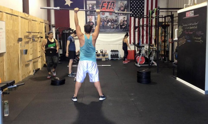FTA GYM - Houston: Four Weeks of Unlimited Boot-Camp Classes at FTA GYM (75% Off)