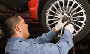 The Tire Giant: Laser Wheel-Alignment, Oil-Change Package, or AC Recharge at The Tire Giant (Up to 74% Off)