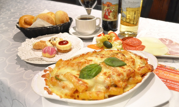 Cafe Diplomatico - Little Italy: C$39 for a Three-Course Prix-Fixe Dinner with 1/2 litre of wine for Two at Cafe Diplomatico (C$67.30 Value)