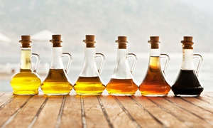 The Smiling Olive: Four or Six 60-Milliliter Bottles of Olive Oil or Balsamic Vinegar at The Smiling Olive (Up to 37% Off)