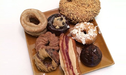 Donuts and Baked Goods at Mojo Monkey Donuts(40% Off). Two Options Available.