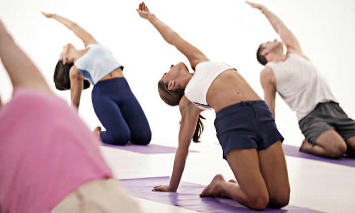 Bikram Yoga - Multiple Locations: Yoga Packages at Bikram Yoga Boston/Harvard Square. (Up to 82% Off). Four Options Available.