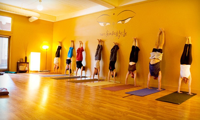 Dharma Yoga - West University: 10 Classes or One Month of Unlimited Classes at Dharma Yoga (Up to 67% Off)