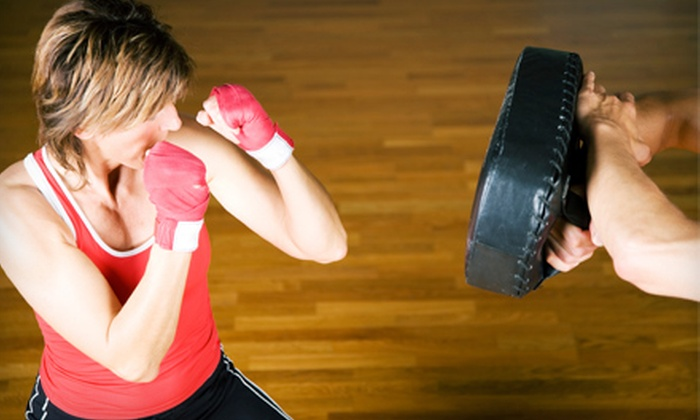 Ultimate Kickboxing & Fitness - Ultimate Kickboxing and Fitness: 10 Cardio-Kickboxing Classes or One or Two Months of Unlimited Classes at Ultimate Kickboxing & Fitness (Up to 70% Off)