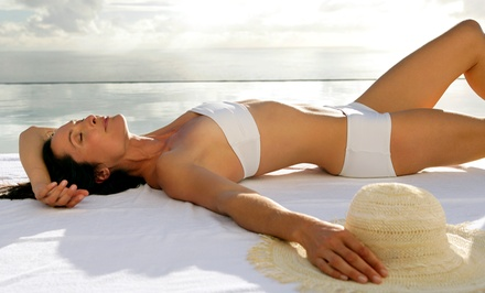 One Month of Tanning in a level 1 or 2 Bed or a Level 3 Bed or One or Two Spray Tans at Tanning Factory (58% Off)