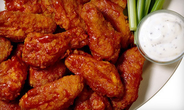 Curly Portable's - Enfield: $14 for 1 Pound of Wings and One Pitcher of Beer at Curly Portable's ($28.11 Value)