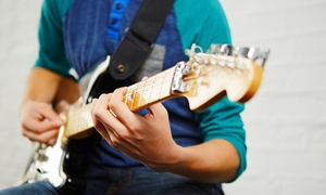 John Henny Music Academy: Four or Eight Private 30-Minute Music Lessons at John Henny Music Academy (Up to 62% Off)