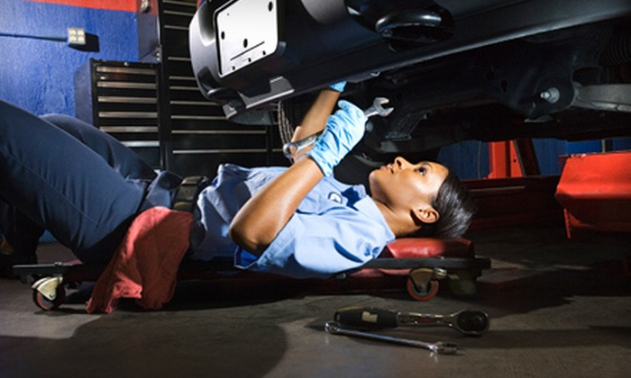 Family Ford Car Care Center - Netcong: Two or Three Oil Changes with Tire Rotations and Brake Inspections at Family Ford Car Care Center (Up to 70% Off)